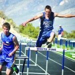 Lund's James Harris and White Pine's Carl Henze race during the 110-meter hurdles. Harris and Henze finished first and second in the race. (Staff photo by Lukas Eggen)