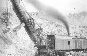 Scoop away. This was the type of shovel used at the Ruth pit in the mid 1920's. Jim Puryear is standing next to the boom.  (Courtesy of J.E. Puryear, Pictorial History book)