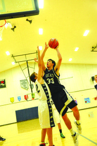White Pine's NIck Johnson goes up for a layup against Silver Stage. (Courtesy photo)