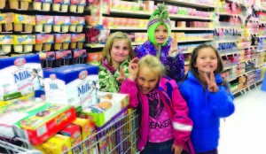 Girl Scout Troop #387 shops to help the Community Food Bank. Pictured McKayla Rowley, True Firth, Roxy Rowley, Natasha Rowley. Not pictured Hannah Dolezal and Addy Kerner. Troop #1349 packs up their donation for the food bank. Pictured Melody VanCamp & Linda Davies, leaders; Mallory Thompson, Kendra Thompson. Kneeling: Karlie Hexem, Graycee Sommervold & Myah Druy. (Courtesy photos)