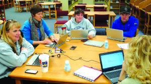 "White Pine teachers train with the Chromebooks that Google supplied to the school as part of its ""Chromebook initiative."" (Garrett Estrada photo)"