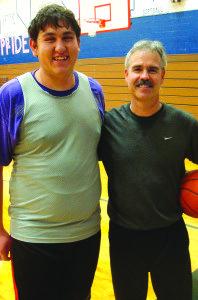 Coach Paul Johnson, right, says senior Seth Lester has become a vocal leader for the White Pine boys' basketball team this season. (Garrett Estrada photo)
