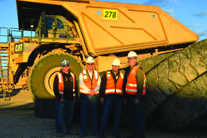 Pictured, from left, in front of a haul truck are Russell Reed, RNMC tire supervisor; Matt Thompson, RNMC supply chain superintendent; Cary Brunson, RNMC general manager; and Michael Herder, BLM Ely District associate district manager. (Courtesy photo)