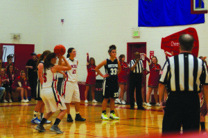 Lincoln County's Tanji Tibbets puts up a free throw while White Pine's Debra Kingston (33) prepares to rebound. (Lincoln County Record photo)