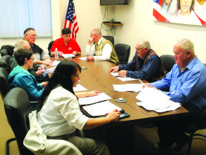 Gary Perea works with the White Pine Water Advisory Committee on Tuesday night. Perea has worked with the eight counties to file a lawsuit against the BLM over the proposed water pipeline from Clark County to rural Nevada. (Garrett Estrada photo)