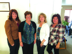 The staff at D&D Financial Services are, from left, Angela Bellander, Loretta Ernest, owner Dee Dee Sandoval and Debbie Ashby. (Garrett Estrada photo)