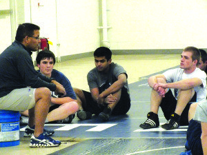 "Wrestling coach Mike Gamberg sits his team down during practice to ""get everything out"" after there below average performance at their last meet at Yerington. The team has one more meet where individuals will be seeded for divisions."