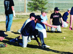 White Pine baseball plays practice proper ground ball technique during practice as part of a coaching effort to improve the team's overall defense. (Garrett Estrada photo)