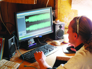 Eric Skye monitors his radio frequency AM 1610 The Loop out from his broadcast studio, located next to his home in Ely.