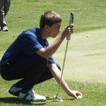 Justin Kirchner sets up for a shot at the home divisional meet.