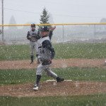 Garrett Estrada Photo White Pine's pitcher Kade Britton throwing in the snow in the first inning of the Bobcats game against West Wendover.