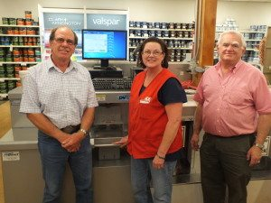 Garrett Estrada Photo Jim Bath, Stacey Corona and Tom Bath stand in front of the store's new, state-of-the-art paint mixing machine. .