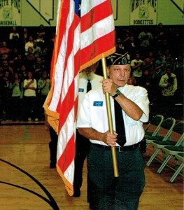Courtesy photo Ken Curto carries the American Flag during a high school assembly for VFW.