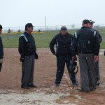 Garrett Estrada  Softball coach Krystal Smith meets with umpires at home plate to suspend their game Tueday..