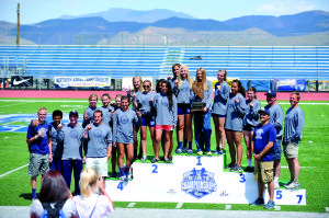 B.J. Almberg Photo The White Pine girls and boys track team pose on the podium after their .first and third place finishes in the state championship meet held in  Carson City on May 24.