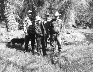 Courtesy photo The Tomera family of Lander County is battling with the Bureau of Land Management over the closure of one of their grazing alloments. Above they are standing in the green grass along Lewis Creek above their ranch. From left is Paul, Lynn, Dan and Pete Tomera.