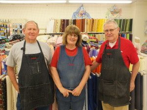 Longtime V&S Variety True Value employees Buddy Sampson and Beverly Terhune stand in the fabric department with the store's owner Ray Hansen.