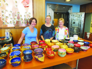 Garrett Estrada Photo April Bath (left) and her mother Margret Bath (right) stand next to local artist Jennifer Messina (center) and her handmade bowls at the Ely Art Bank.
