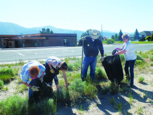 Garrett Estrada Photo Patrice Lytle and her husband Cory help cleanup trash alongside Great Basin Boulevard as part of Ely's Cleanup Day.