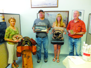 Garrett Estrada Photo White Pine Public Museum staff pictured holding pieces from the new Pony Express exhibit. Pictured from left to right: Joyce Christensen, former Museum Director Howard Bohrn, new Museum Director Monica Simon and Bill Wilson.