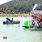 """Johnathan Rice gets ready to race """"Hillbilly Deluxe"""" bathtub boat at Cave Lake. (Courtesy Photo)"""