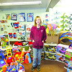 Taryn Farnworth stands in the newly opened bargain basement section at Bradley's Bestway Market in McGill.
