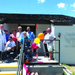 Dialysis patients and doctors gather in front of the Sanderling Dialysis Center for its ribbon cutting grand opening on Monday. Garrett Estrada photo