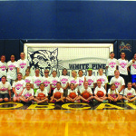 The White Pine High School Ladycat basketball team poses with participants of their basketball camp held in the high school's gymnasium on Tuesday. Garret Estrada photo