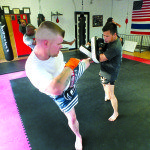 Garrett Estrada Martial artist Rey Aquino works with student Mike Shilito during a Muay Thai class at the Sain Dae Muay Thai gym. Garrett Estrada Photo