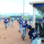 Garrett Estrada Photo The White Pine All-Stars run out of the dugout after coming back from seven runs down to beat Elko 14-13 on Friday.