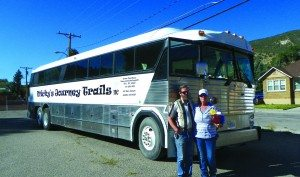 John and Mary Coppock stand in front of their new bus, which they will use as a charter service for Ely residents. (Teresa Stewart photo)