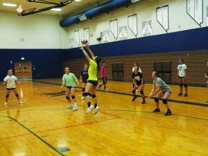 Senior Ashlynn Huntington sets up a ball for her teammates at a practice in WPHS's gymnasium. (Garrett Estrada photo)