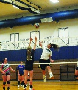 Debra Kingston goes to break through a block with a spike over the net at a varsity team practice on Tuesday afternoon. (Garrett Estrada photo)