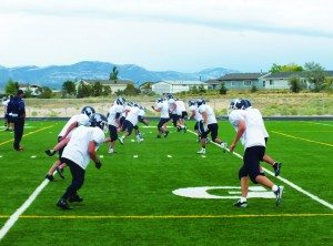 The White Pine High School Football team practices tackling on their home field on Tuesday. First-year head coach Quinn Ewell said that teaching proper tackling is going to be key if the Bobcats hope to improve on their winless record from last season. (Garrett Estrada photo)
