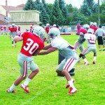 Freshman defensive back Dalton Baker makes a move to get around freshman defensive back Tim Hough at a UNLV football practice at Broadbent Park. (Garrett Estrada photo)
