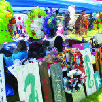 Booths filled with handmade pieces of artwork covered County Park Saturday and Sunday as part of this year's Arts in the Park. (Garrett Estrada photo)