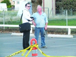 Forensic Auditor and Fraud Examiner Nicholas Miller speaks with City Councilman Marty Westland in the railroad's parking lot Tuesday night.  (Garrett Estrada photo)