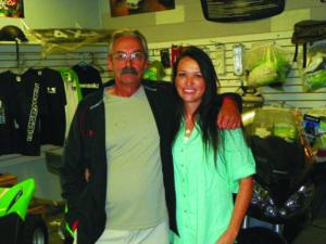 Salesman Chuck Hutton and Sahara Motors General Manager Sandi Greathouse pose in their Kawasaki showroom. (Garrett Estrada photo)