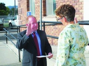 Robert Switzer gets sworn into office as the new City Clerk Monday. (Garrett Estrada photo)