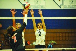 Ashlyn Huntington and Debra Kingston go to block a shot during their preseason tournament. (B.J. Almberg photo)