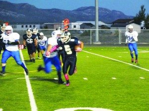 Tommy Hart runs for a first down against Laughlin in the Bobcat's blowout win on Oct. 2. (Garrett Estrada photo)