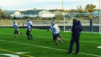 Jacob Baer runs a drill in front of Bobcat football coach Quinn Ewell at practice Monday. Baer will play his last game Thursday. (Garrett Estrada photo)