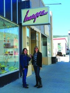 The new owner of Images Salon Laura (left) takes the keys to the store from the salon's previous owner Melanie.   (Teresa Stewart photo)