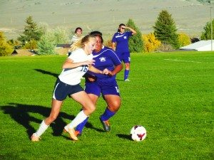 Lucy Fullmer of White Pine dribbles a pass around a Yerington defender in the Ladycat's 7-0 home win on Oct. 10. (Garrett Estrada photo)