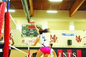 Emily Bischoff spikes a ball against the Mountain View Christian Saints on Oct. 25.(Courtesy photo)