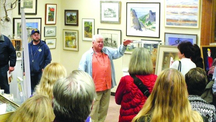 "Art collector Wally Cuchine speaks to a crowd gathered at the Ely Art Bank on Nov. 14 in front of selected pieces from his collection ""Wally's World: The Loneliest Art Collection in Nevada"" which has been touring the state for over a year. (Garrett Estrada photo)"