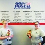 """Shasta Drake and Kandy Cox hold their """"elf on a shelf"""" inside the new location for Goin' Postal off of Aultman Street."""