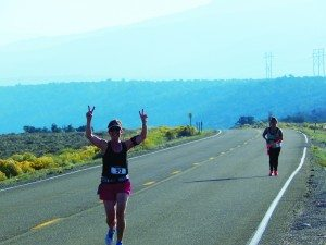 A participant in the Take it to the Lakes half marathon holds up the peace sign during the run that took place at Cave Lake State Park on Sept. 20. (Courtesy photo)