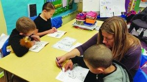 Learning Bridge teach of the month Heidi Tokerud helps one of her students. (Courtesy photo)