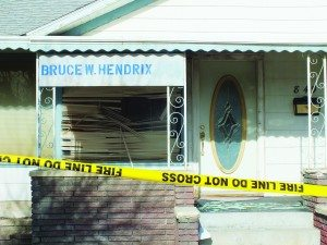 Hendrix's accounting business window was shattered and burned in a second arson fire Monday. (Garrett Estrada photo)